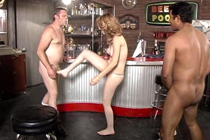 Two guys with feet fetish fuck a girl at the bar