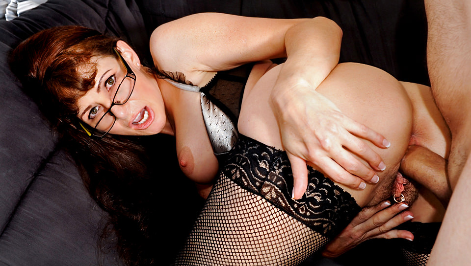With her sexy glasses on, she takes hard cock